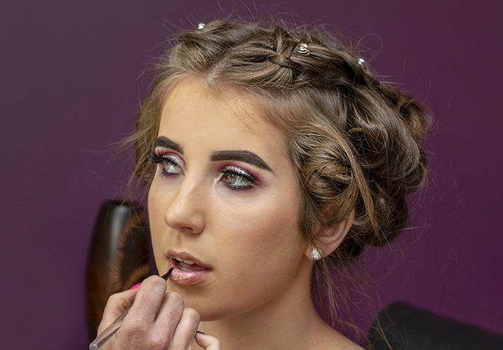 Bridesmaid having makeup done