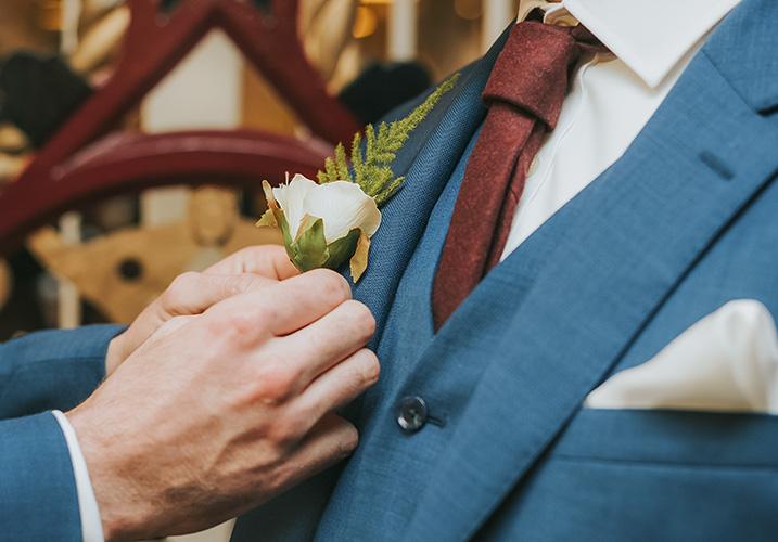 David having a pocket wedding flower put on