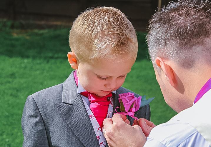 son getting ready for wedding