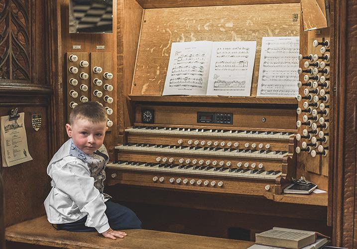 young boy in church on a wedding day