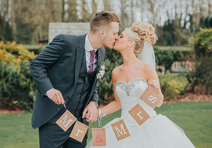 Groom-kissing-the-bride
