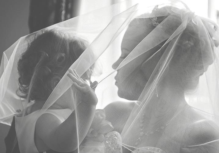 young girl under wedding veil