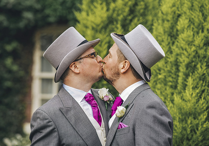 groom kissing best man