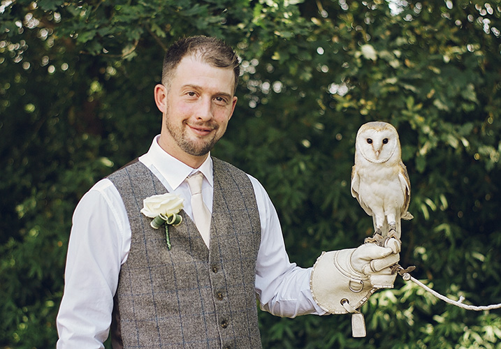 Best man holding an owl