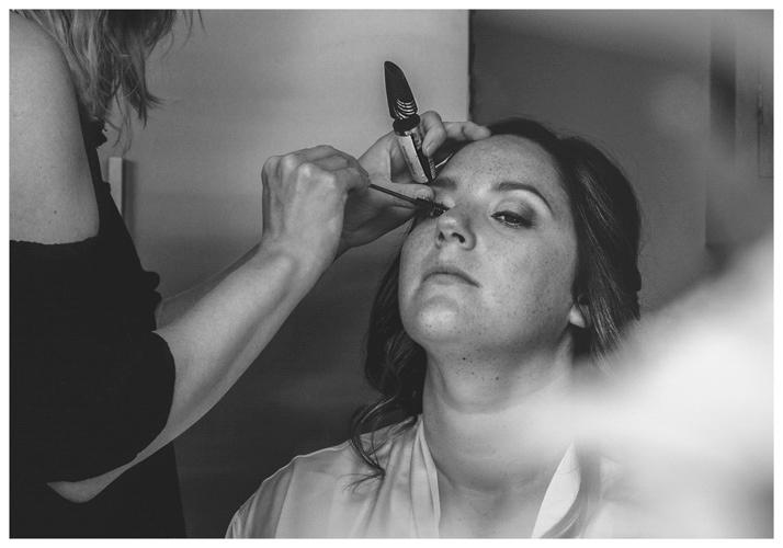 Bride having makeup done