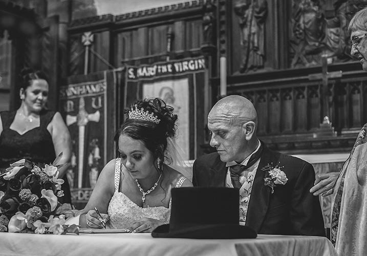 Couple signing the register