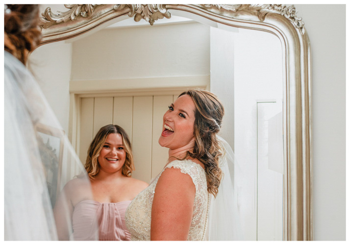 Bride looking into the mirrow