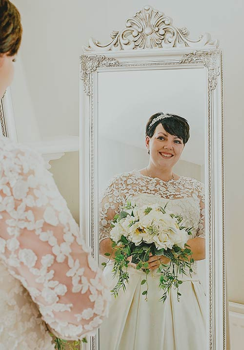 Bride is looking in the mirror