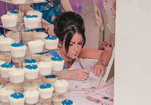 bridesmaid writing in the guest book