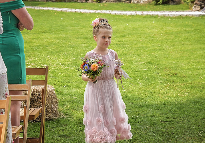 Bridesmaid holding flowers