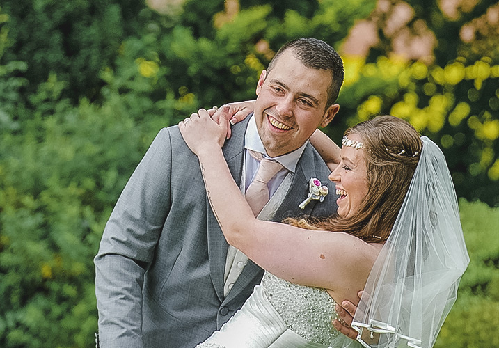 Groom and bride laughing