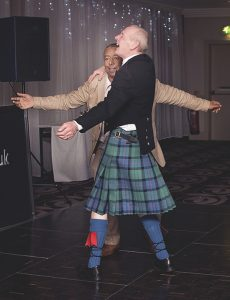 groom dancing with his friend at his wedding reception
