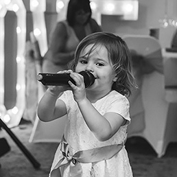 young girl singing karaoke at a wedding